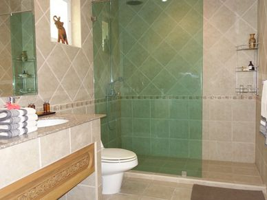 3 chic ensuite-bathrooms are given