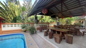A Sala besides the pool