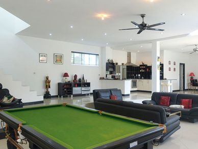A game of snooker in the pleasantly cool living area