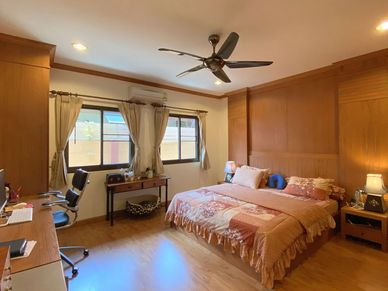 A huge bedroom with office facilities