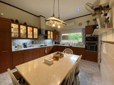 A huge kitchen with all amenities and in a separate room