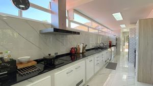 A large, modern and well-equipped kitchen