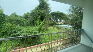 A large balcony with views to greenery