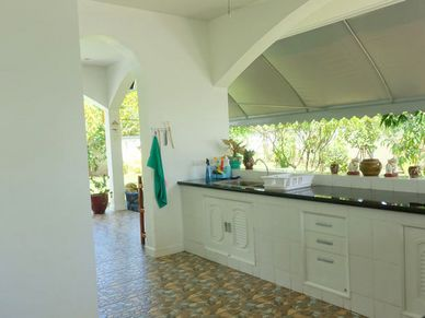 A large covered outdoor kitchen