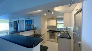 A large kitchen with breakfast bar