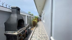 A pizza oven besides the house