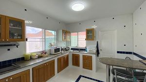 A spacious kitchen with a breakfast counter