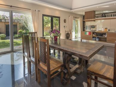 Across the dining-table to the kitchen