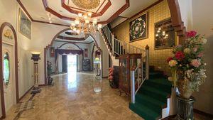 Across the hallway, going upwards