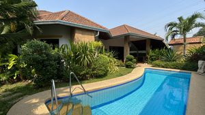 Across the pool and greenery to the house