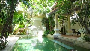 Across the pool to the covered Sala