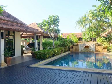 Across the pool with the guest bungalow in your back