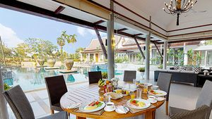 Al fresco dining besides the pool