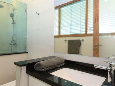 All 3 bathrooms have rain-shower