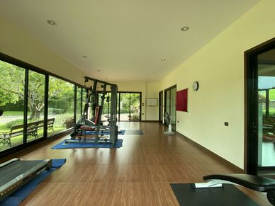 An airy gym with nature views