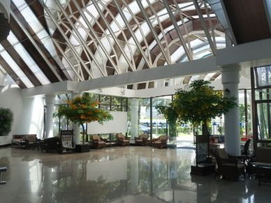 An impressive lobby with lounge area, reception and some shops
