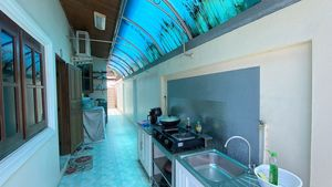 An outdoor Thai kitchen and a new washing-machine