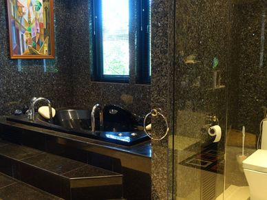 Bathroom with double sink, shower cubicle and bathtub