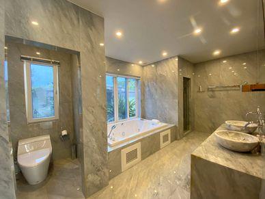 Beautiful marble and a Jacuzzi bathtub - the master-bathroom.jpg