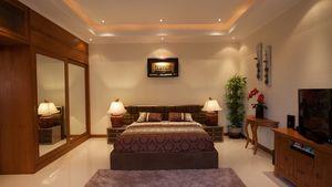 Bedroom with built-in wardrobes and en-suite bathroom