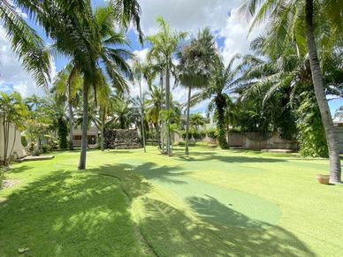 Communal putting-greens and party area with direct access from the villa