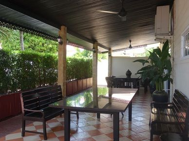 Cosy outdoor areas - the bar is on the opposite side