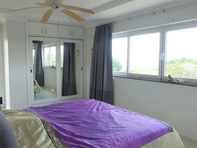 Great views, access to the terrace and built-in wardrobes - the master-bedroom