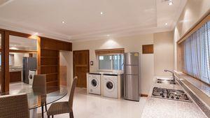 Kitchen with fridge and laundry machine