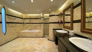 Large granite bathrooms, here with shower cubicle and bathtub