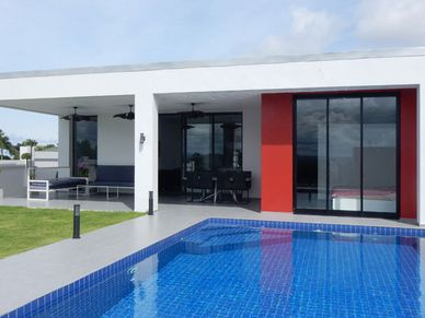 Look across the pool towards the villa