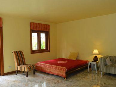 Marble floors throughout - the ground-floor bedroom