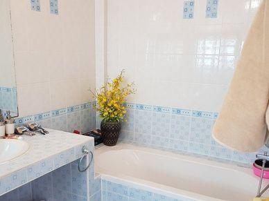 Master bathroom with a bathtub
