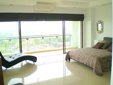 Master bedroom views at this modern golf course sea view condo, Sri Racha