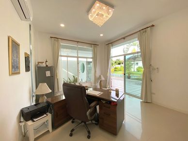 One bedroom is currently used as an office