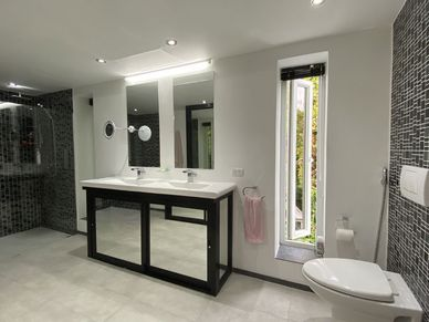 One of five modern and spacious bathrooms