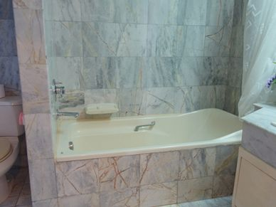One of three bathrooms - all full in marble