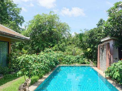 Overlooking pool and greenery