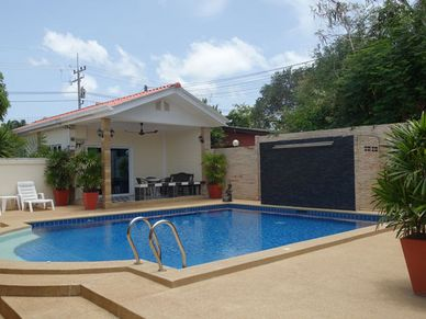 Pool, waterfall feature and private bungalow