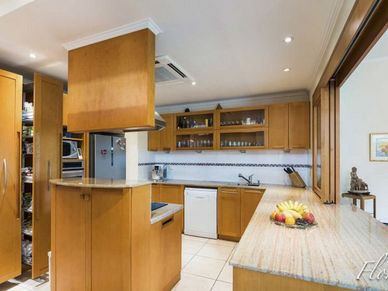 Solid teak and well-equipped, the kitchen