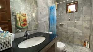 The 2 bathrooms are fully tiled in beautiful marble