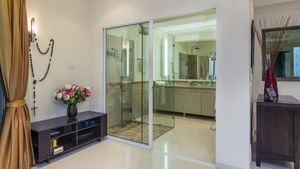 The 3 main bathrooms are all modern