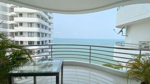 The balcony wraps all around the corner-condo