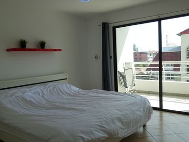 The bedrooms offer direct access to a balcony