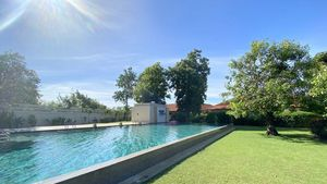 The communal pool right next to the property