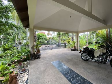 The covered carport with views to the access road