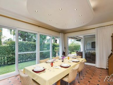 The dining-room with the outdoor terrace further back