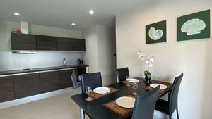 The dining-table with the kitchenette in the background