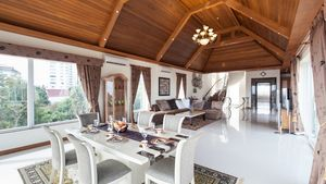 The dining area on the top floor with a beautifully designed sloped wooden ceiling