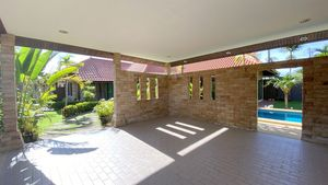 The double carport, staff quarters and storage