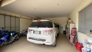 The garage holds 2 cars and is remote-controll